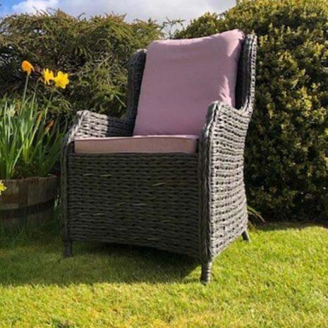 Rye Dark Rattan Dining Armchair with lilac cushions