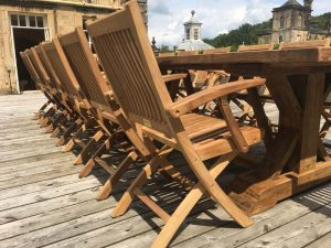 Gainsborough Folding Teak Armchairs with a Hockney Reclaimed Teak Table at Castle Howard, York