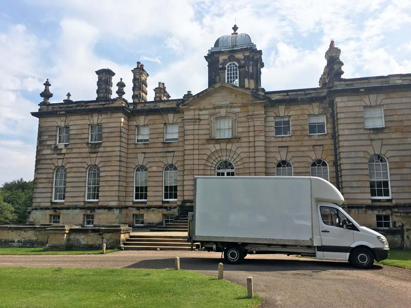 The well travelled Rattan And Teak white van arrives at Castle Howard