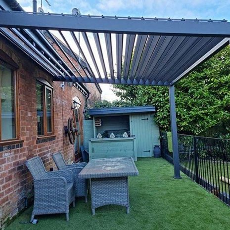 Namib Aluminium Wall Mounted Pergola Sloping Vented Roof - Side view